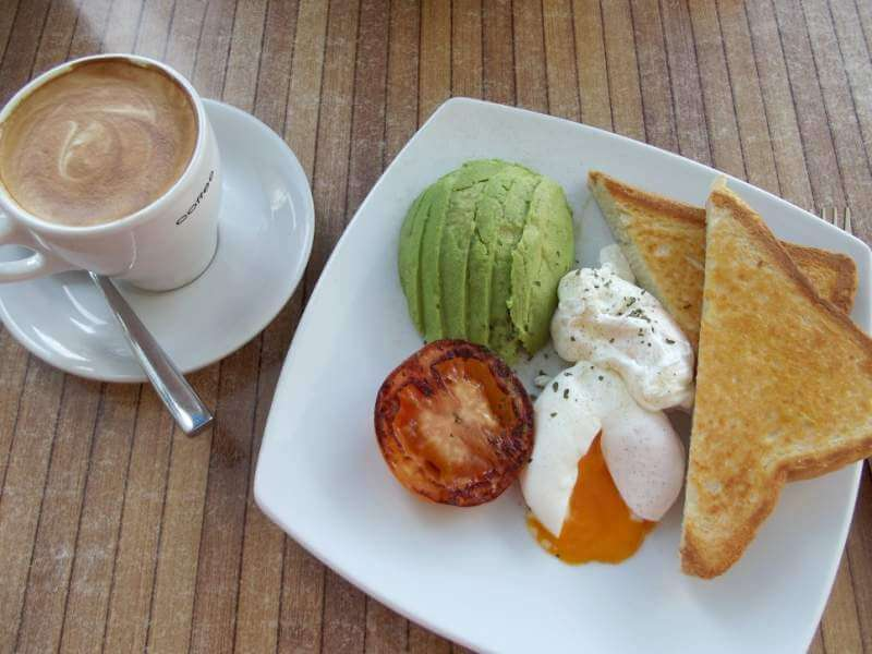Coffee and Breakfast! Poached eggs, avocado, grilled tomato and toast