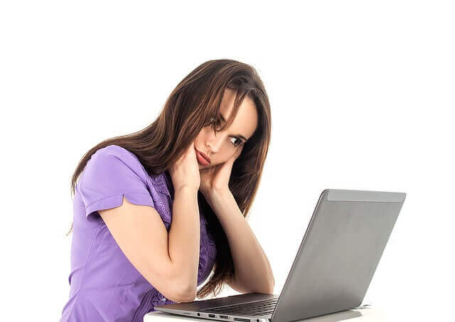 girl-thinking-laptop