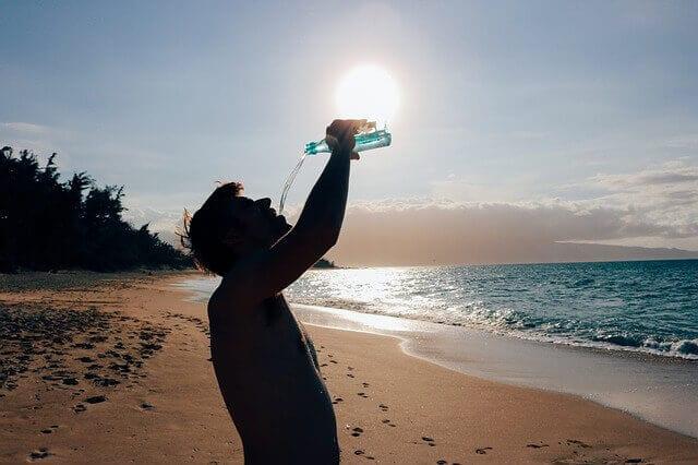 man-drnking water