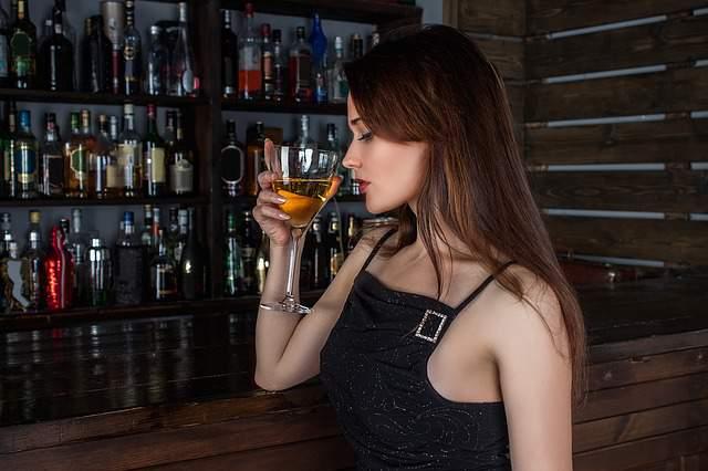 Beautiful girl drinking alchol