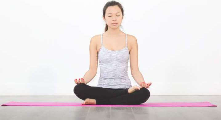 woman-yoga-mat-meditation