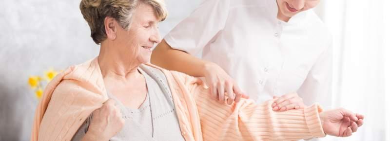 Young nurse helping elderly woman