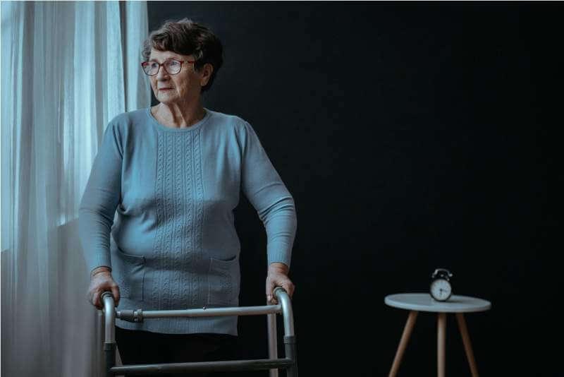 Lady holding a walker