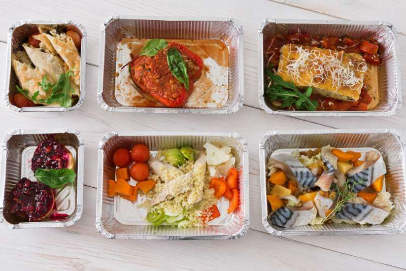 healthy-food-take-away-in-boxes-top-view-on-wood