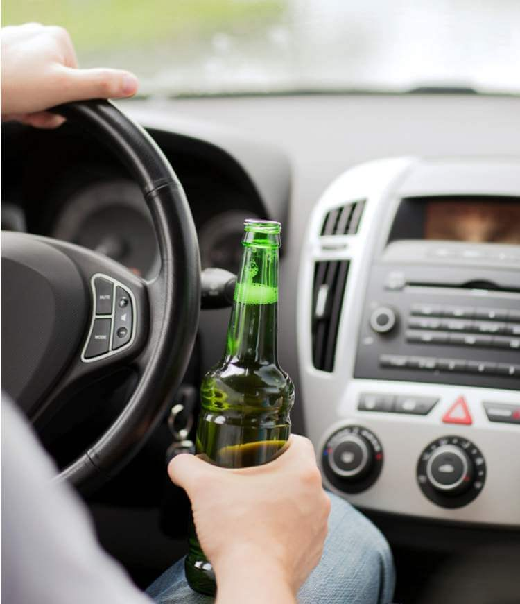 man-drinking-alcohol-while-driving-the-car