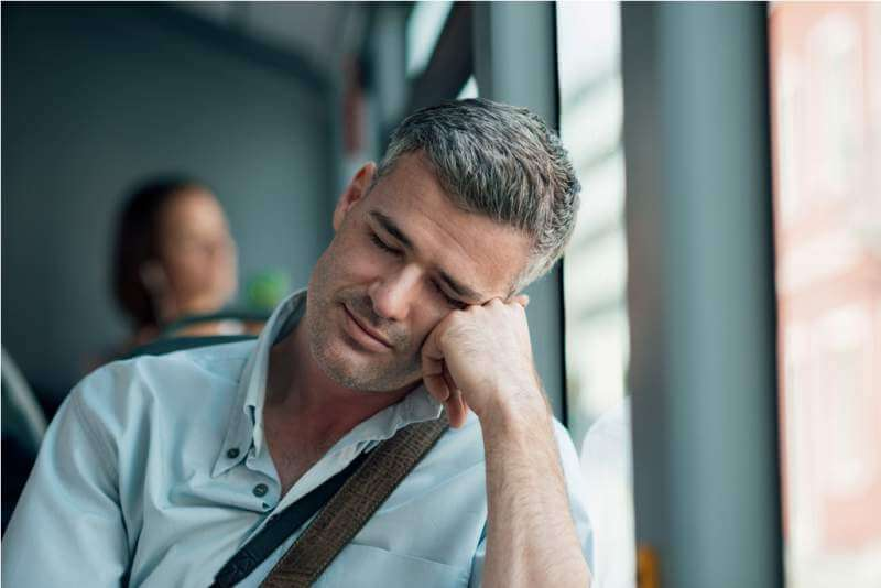 man-sleeping-on-the-bus