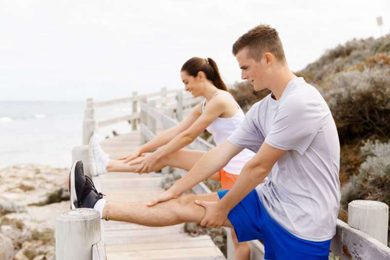 runners-young-couple-exercising-and-stertching