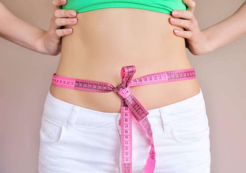 woman-measuring-waist-with-tape-on-knot-dieting