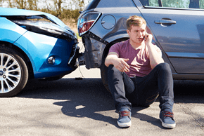 Men Talking in Phone After Car Accident