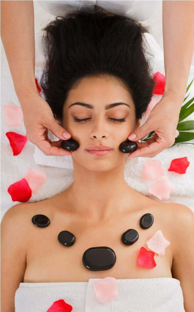 beautician-make-stone-massage-spa-for-woman