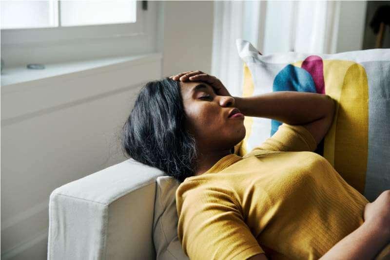 black-woman-headache-and-sleeping