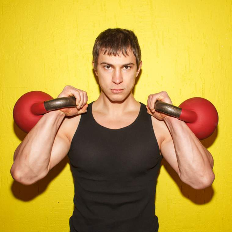 brutal-muscular-guy-with-weights-isolated