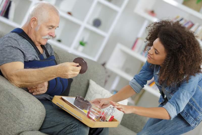 carer-serving-meal-to-injured-senior-citizen