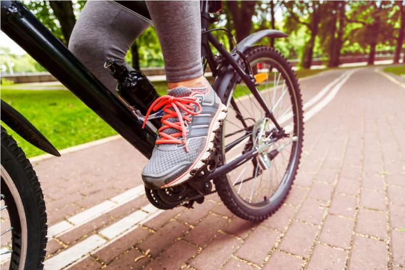 close-up-image-of-cyclist-man-feet-riding