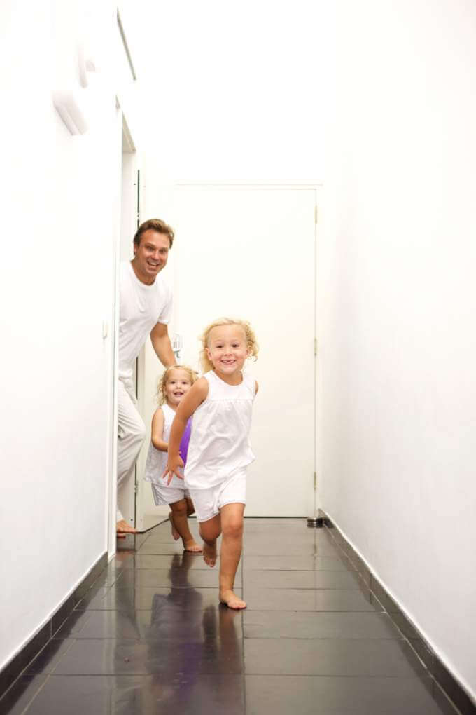 cute-little-girls-running-at-home-with-father