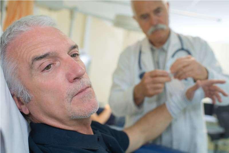 doctor-bandaging-patient