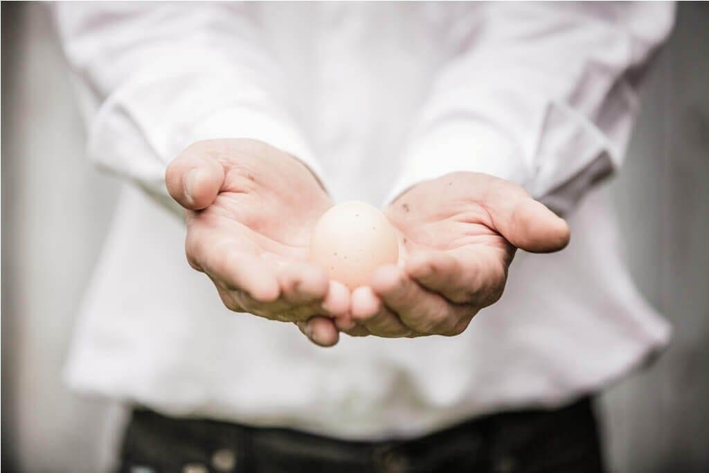 farmer-showing-an-egg