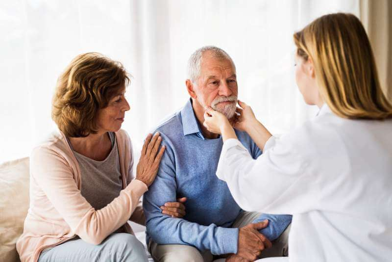 female-doctor-examining-a-senior-man