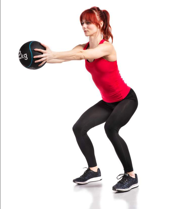 fitness-woman-in-red-tank-top-holding-medicine