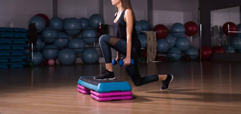 fitness-woman-with-step-platform-doing-workout