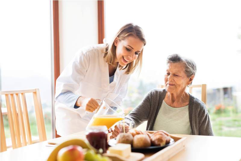 health-visitor-and-a-senior-woman-during-home