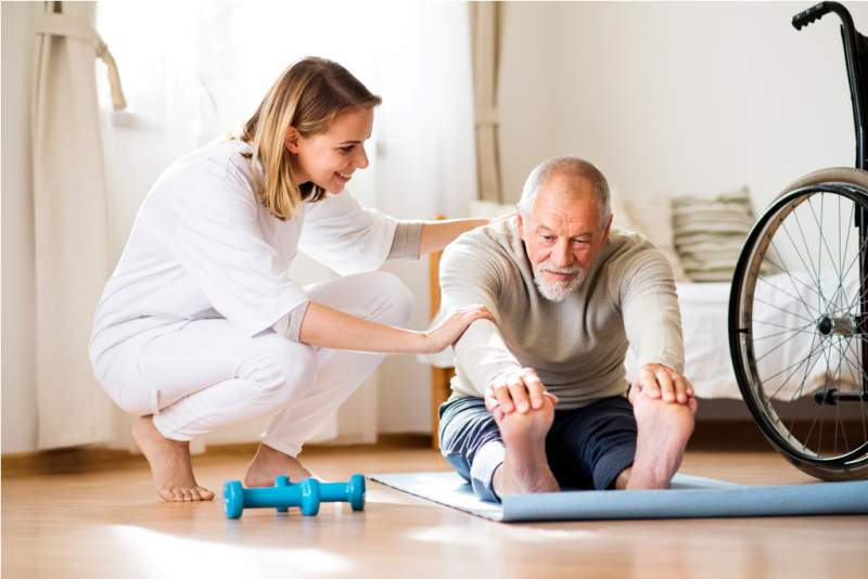 health-visitor-and-senior-man-during-home-visit