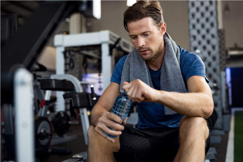 man-with-water-bottle-at-gym