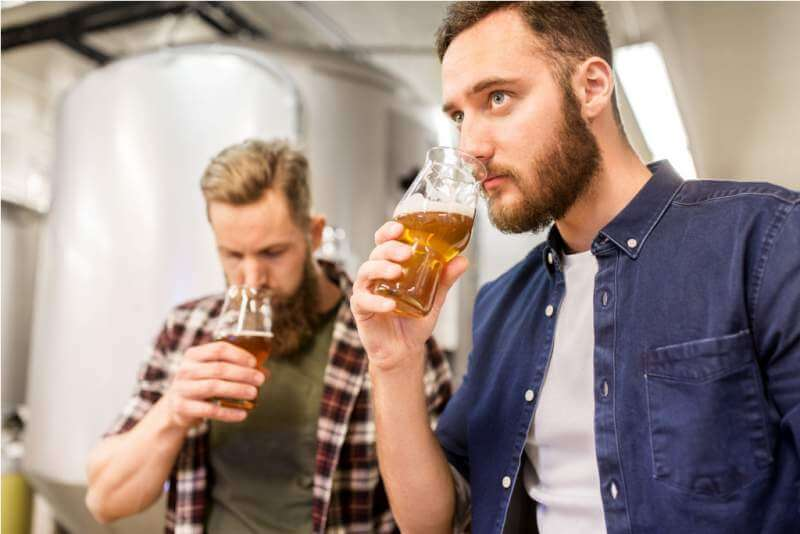 men-drinking-and-testing-craft-beer-at-brewery