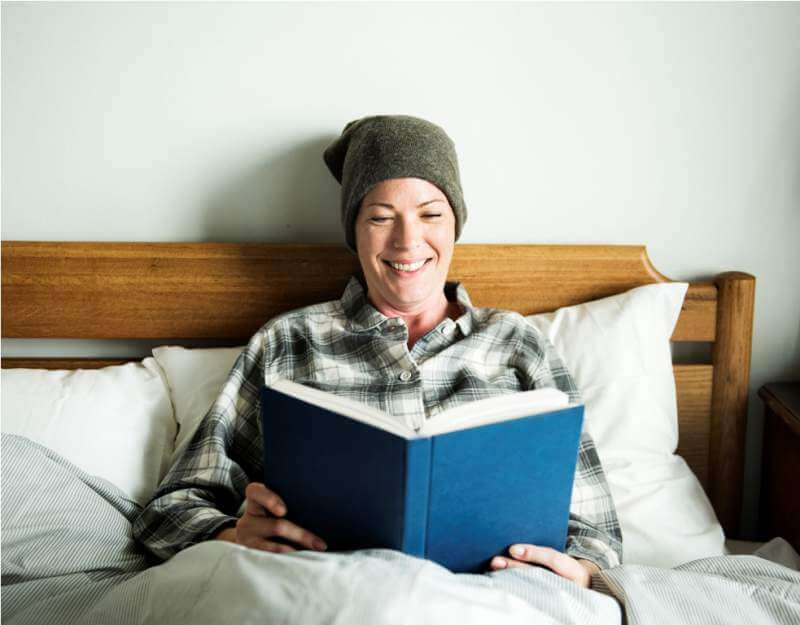 patient-reading-in-bed