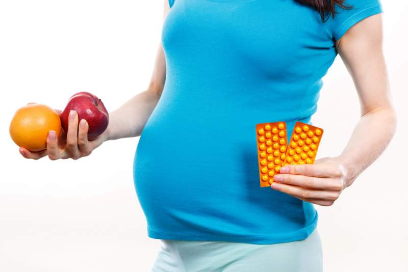 pregnant-woman-holding-fresh-ripe-fruits
