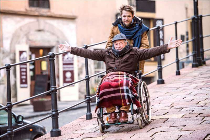 senior-father-in-wheelchair-and-young-son