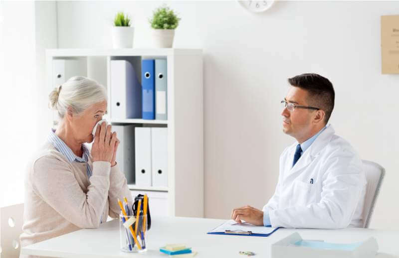 senior-woman-and-doctor-meeting-at-hospital