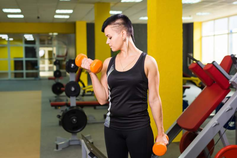 strong-fit-girl-exercising-with-dumbbells