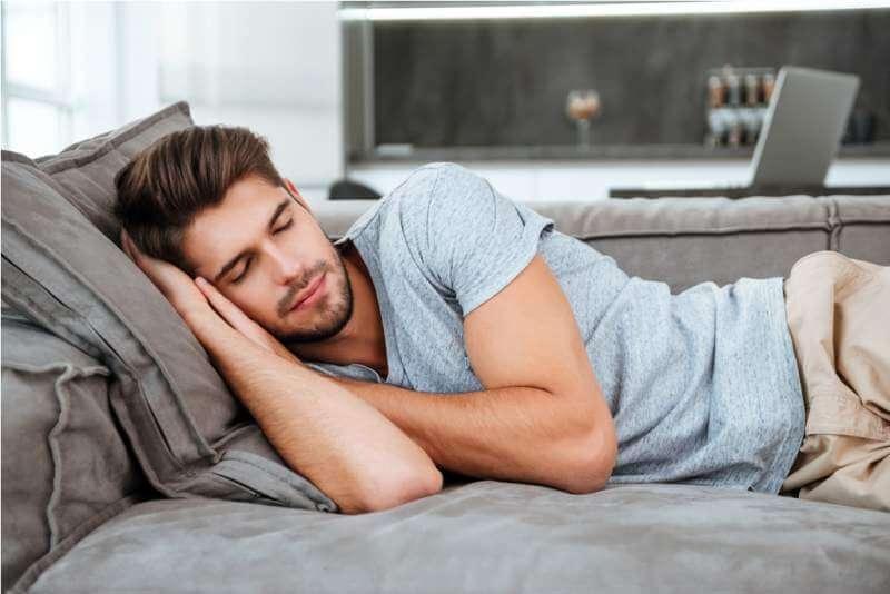 tired-man-sleeping-on-a-sofa