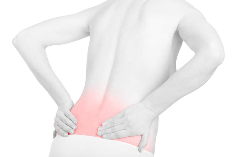 young-adult-woman-with-back-pain-red-area