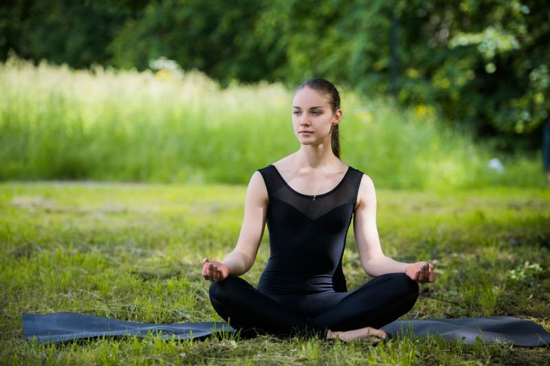 young-girl-doing-yoga-in-the-park
