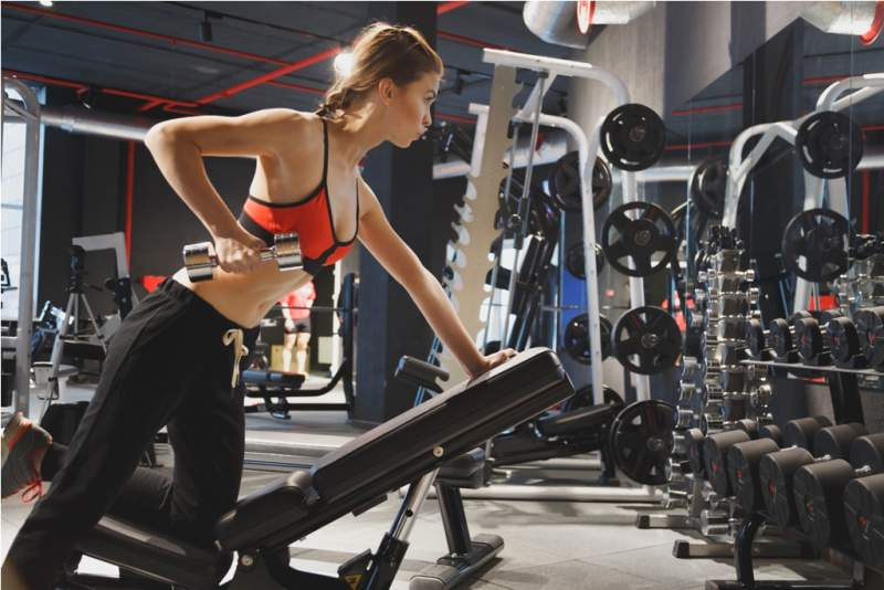 young-sports-woman-doing-exercises-with-dumbbells