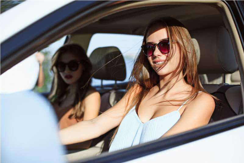young-women-in-the-car-smiling