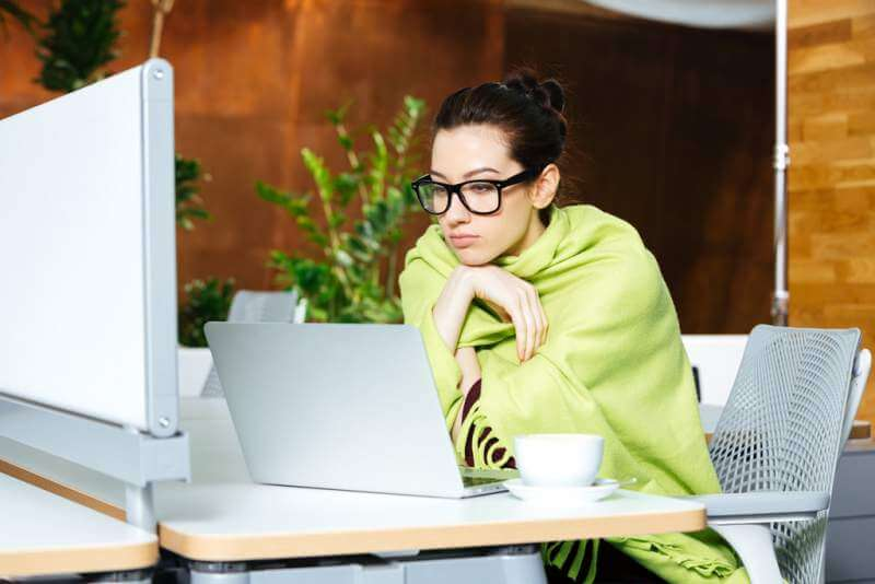 beautiful-thoughtful-woman-using-laptop