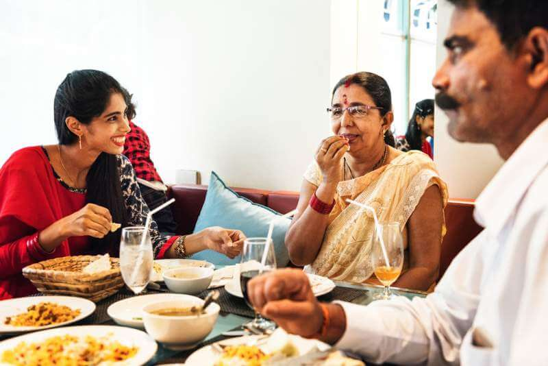 family-having-indian-food