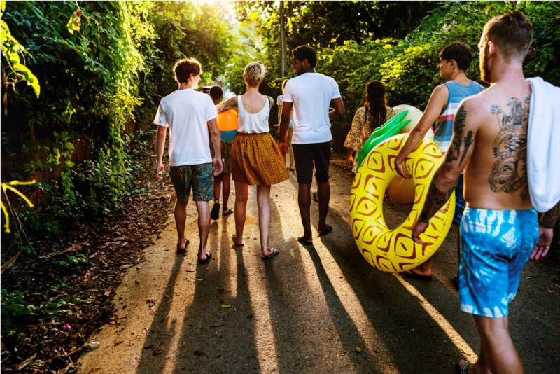 group-of-diverse-friends-walking-in-summer-time