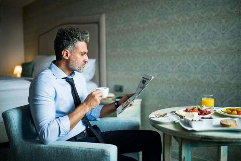 mature-businessman-having-breakfast-in-a-hotel