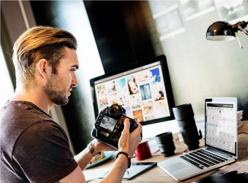 photographer-working-checking-photo-concept