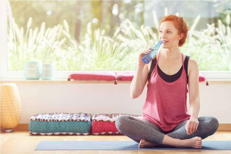 woman-drinking-water-after-pilates