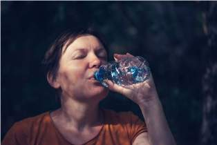 woman-drinking-water-outdoors