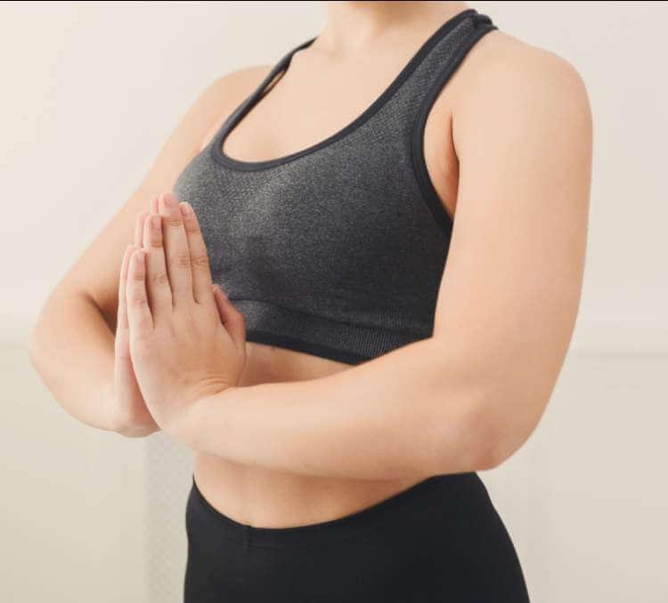 woman-practicing-yoga-in-padmasana