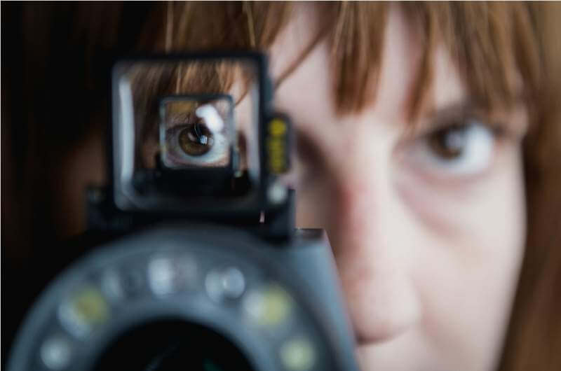womans-eye-in-viewfinder
