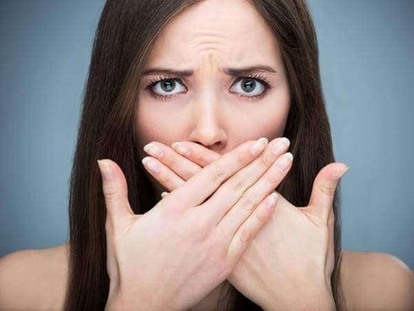 women hiding bad breath smell