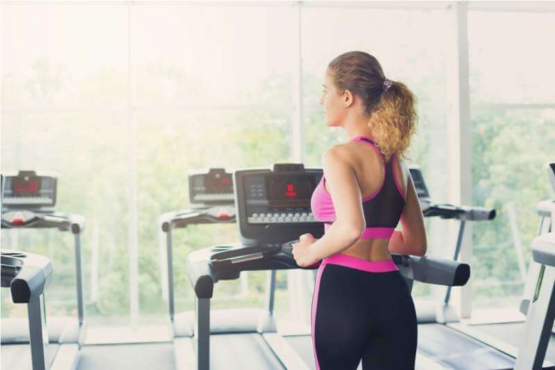 attractive-woman-on-treadmill-in-fitness-club
