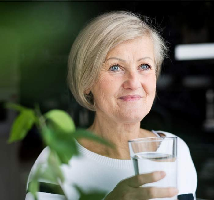 senior-woman-holding-a-glass-of-water